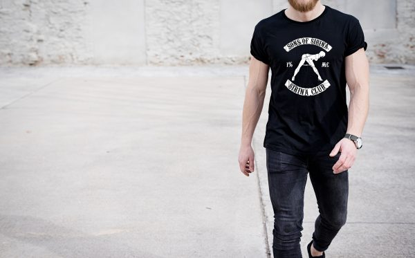 Young,Muscular,Man,Wearing,Black,Tshirt,And,Jeans,Walking,On